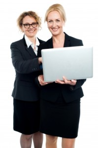 Ladies Using Laptop by stockimages