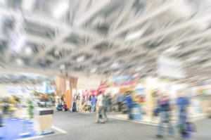 Generic trade show stand with blurred zoom defocusing - Concept of business social gathering for international meeting exchange